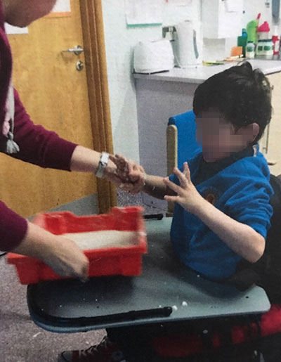 A campaigning mum has won cross-party support for her calls to reduce restraint in Northern Ireland's special schools.